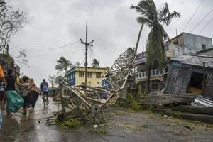 A damaged mobile tower seen struck down on road due to Cyclone Titli at Barua village of Srikakulam in Andhra Pradesh on Thursday.