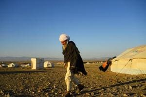 Photos: Afghan farmers fleeing drought face more hardship in camps