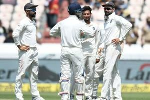 Indian cricketer Kuldeep Yadav (C) celebrates with captain Virat Kohli (R) after the dismissal of West Indies cricketer Shimron Hetmyer during the first day