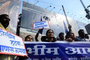 Members of Jai Bhim army stage a protest demanding removal of all hoardings near the RTO on Thursday.