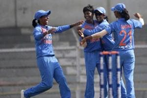 File image of players of India women's cricket team celebrating the fall of a wicket during a match.