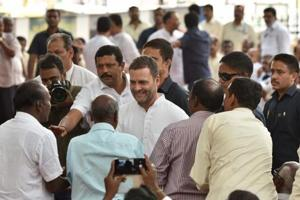 Congress president Rahul Gandhi interacting with HAL workers at Minsk square in Bengaluru on Saturday.