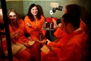 Guests sit in their cells at the Alcotraz Prison Cocktail Bar in east London.