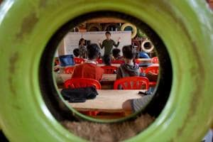 Photos: Cambodian school teaches children recycling, takes fees in trash