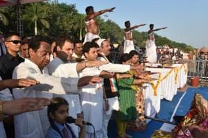 Congress president Rahul Gandhi along with party leaders Jyotiraditya Scindia and Kamal Nath take an oath for cleaning Narmada during Maha Aarti at Gawari Ghat in Jabalpur in Madhya Pradesh.