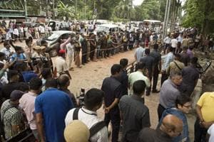 A crowd gathers at the site of an explosion near a busy market in Guwahati, India, Saturday, Oct. 13, 2018. The explosion took place outside the office of a district magistrate, but it is unclear whether the official was the target, said senior police officer Harmeet Singh.