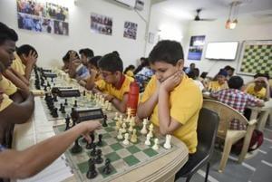 Children learning chess at Matrix Chess Academy at Maliviya Nagar, in New Delhi.