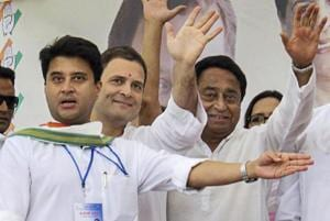 Congress president Rahul Gandhi, Congress leader (second L) Jyotiraditya Scindia (L) during a roadshow in Bhopal, Sept 17, 2018.