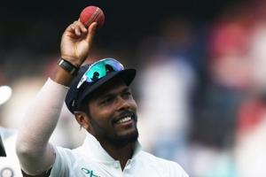 Indian Bowler Umesh Yadav shows the ball for the ten (10) wickets haul in the match during the third day
