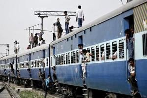 A file photo of passengers standing on top of an overcrowded train at Loni town in Uttar Pradesh. (Reuters photo)