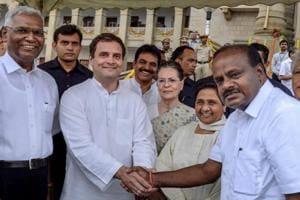BSP leader Sonia Gandhi shakes hands with Congress president Rahul Gandhi during Karnataka CMHD Kumaraswamy's swearing in ceremony, May 23, 2018.