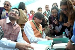 Author and Congress MP Shashi Tharoor signing books on the second day of the Khushwant Singh Literature Festival in Kasauli on Saturday.