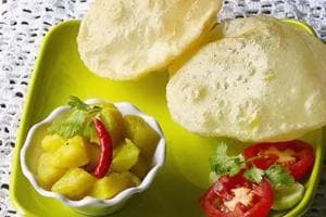 Deep-fried luchi with potato curry is a must-try, it perfectly balances sweet, sour, pungent and spice.  (Shutterstock)