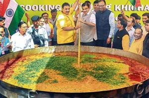 Chef Vishnu Manohar with Union minister Nitin Gadkari cooks 3,000 kg khichdi to create a world record, in Nagpur, Maharashtra, on October 14.