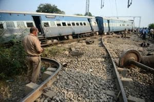 A police personnel stands the site where the engine of the New Farakka Express train derailed along with eight coaches near Harchandpur Railway station in Rae Bareli on October 10, 2018.