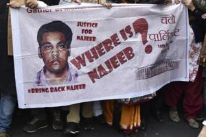 JNU students with missing JNU Student Najeeb Ahmed's mother Fatima Nafees during a protest march against Delhi Police in New Delhi on December 14, 2016.