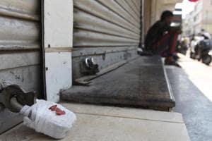 File photo of a sealed shop in South Delhi's Lajpat Nagar IV.