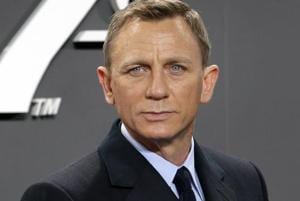 Daniel Craig poses for the media as he arrives for the German premiere of the James Bond movie Spectre in Berlin, Germany.