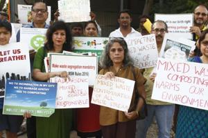 Citizens gather outside the Ecogreen transfer station opposite Paras Hospital to protest Ecogreen