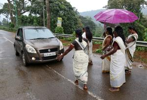 Devotees stop a car to check if any women of menstruating age are headed towards the Sabarimala temple, at Nilakkal Base camp in Pathanamthitta district, Kerala.