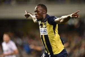 Usain Bolt celebrates after scoring a goal for A-League football club Central Coast Mariners.