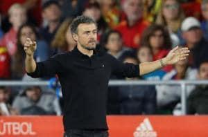 Spain coach Luis Enrique gestures during the match against England.