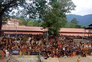Devotees wait for the Lord Ayyappa temple gates to open.