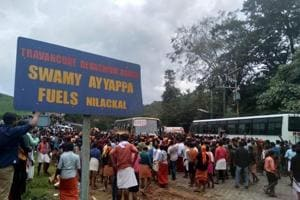 Protestors block vehicles to scan for women at base camp Nilakkal on Wednesday.