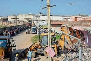 Demolition drives have been carried out in villages after the high court banned construction within 100 metres of the airport.