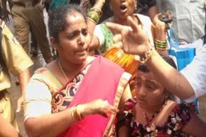 A woman devotee from Andhra Pradesh (in photo) and her family, on their way to the Sabarimala temple, were forced to turn away midway by protesters opposing the entry of women of menstrual age to the hill shrine in Kerala, Wednesday, October 17, 2018.