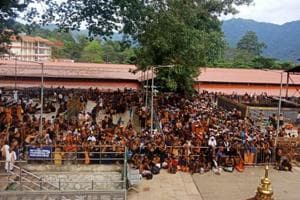Television channels showed hundreds of people surrounding Prasanna's car in Nilakkal town of the district as the protesters chanted Ayyappa slogans.