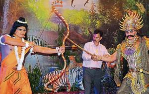 Mohit Kumar donning the role of Ram engaged in a duel with his brother Rohit Kumar as Ravana, as their father Pradeep Kumar looks on at Navyug Ramlila in Sector 7, Chandigarh.