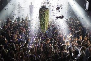 """People in Toronto gather at a local concert venue to watch the """"bud drop"""" at the stroke of midnight, in celebration of the legalization of recreational cannabis use on October 17, 2018 in Canada."""