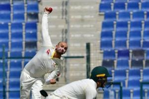 Australia cricketer Nathan Lyon bowls during day one of the second Test cricket match in the series between Australia and Pakistan at the Abu Dhabi Cricket Stadium in Abu Dhabi on October 16, 2018