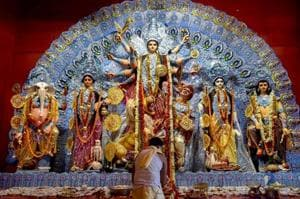 """A priest offers Maha Ashtami """"Sandhi Puja"""" at a Puja pandal during the ongoing Durga Puja festival."""