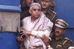 Self-styled godman Rampal being brought to court in Chandigarh in 2014. Rampal was arrested that year 2014 following a days-long standoff between the police and his supporters in which six people died and hundreds were injured.