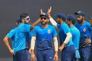 Delhi bowler Manan Sharma (L) and his teammates celebrate after taking the wicket of Saurashtra batsman Sheldon Philip Jackson (not in the picture) during the Vijay Hazare trophy cricket match.