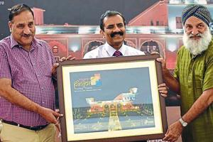Haryana additional chief secretary Vijay Vardhan (centre) and thespian GS Channi (right) releasing a poster of the 11th Pinjore heritage festival on Wednesday.