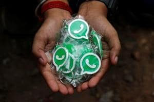 A WhatsApp-Reliance Jio representative displays key chains with the logo of WhatsApp for distribution during a drive by the two companies to educate users, on the outskirts of Kolkata, India, October 9, 2018. REUTERS/Rupak De Chowdhuri