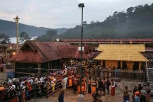 Devotees wait in queues inside the premises of the Sabarimala temple in Pathanamthitta district in Kerala, India, October 18, 2018.