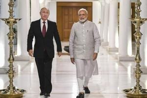 Prime Minister Narendra Modi and Russian President Vladimir Putin before their meeting in New Delhi on October 4.