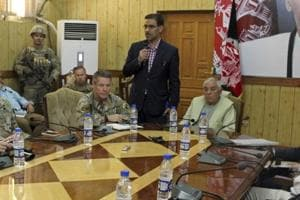 The head of NATO troops in Afghanistan, Gen. Scott Miller, center left, Kandahar Gov. Zalmay Wesa, center right, and their delegations attend a security conference, in Kandahar, Afghanistan, Thursday, Oct. 18, 2018.