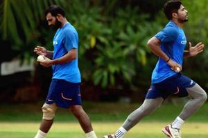 Mohammed Shami (L) and Umesh Yadav during a practice session.
