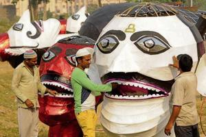 Muslim artistes giving final touches to effigies on Thursday for Dussehra celebrations on Friday in Patiala.