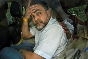 Ashish Pandey, accused of brandishing gun at guests outside a hotel, being brought out of the Patiala House Courts in New Delhi, Thursday, Oct 18, 2018.