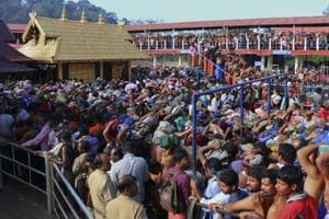 Worshippers stand in queues outside the Sabarimala temple. Protests erupted in many places in Kerala on Friday over the disruption of pooja in Sabarimala earlier in the day shortly before two women were forced to return from the vicinity of the temple.