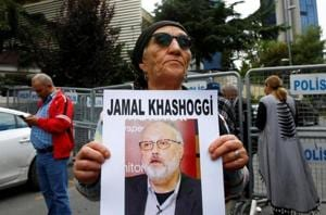 A human rights activist holds picture of Saudi journalist Jamal Khashoggi during a protest outside the Saudi Consulate in Istanbul, Turkey on October 9, 2018.