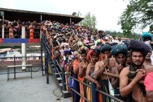 Devotees wait in queues inside the premises of the Sabarimala temple in Pathanamthitta district in Kerala, on October 17, 2018.