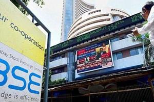 Broadly negative Asian markets, along with a marginal rise in global crude oil prices, dragged the key domestic equity indices in the red during the afternoon trade session on Friday.