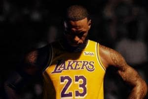 LeBron James poses in the La Lakers after signing with the team.